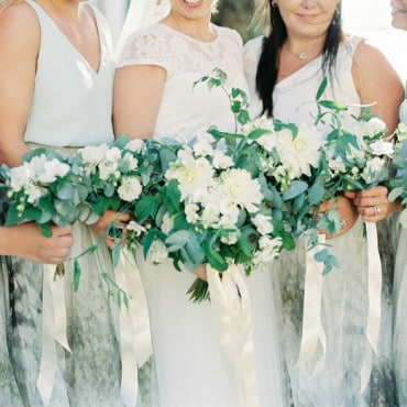 Bride with bridesmaids flowers detail